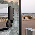 Broken_glass_on_phone_booth
